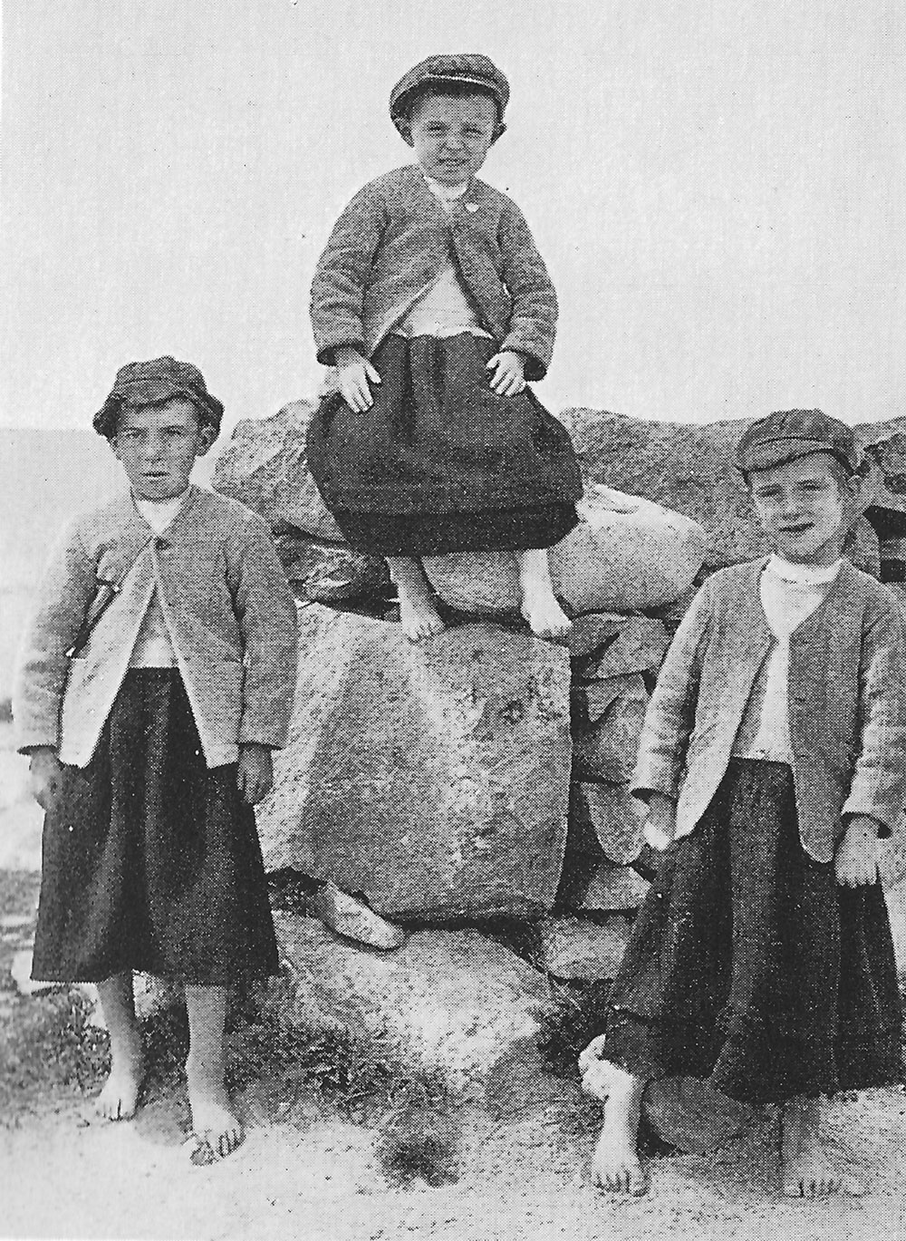 Cheating the fairies: it was a tradition in County Galway to dress boys up to the age as girls to prevent them being taken by fairies. Photo by Donn Byrne, 1927.